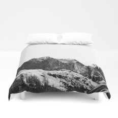 Mountains are Calling Duvet Cover    Cover yourself in creativity with our ultra soft microfiber duvet covers. Hand sewn and meticulously crafted, these lightweight duvet covers vividly feature your favorite designs with a soft white reverse side. A durab