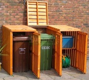 Storage for garbage and recycling bins.