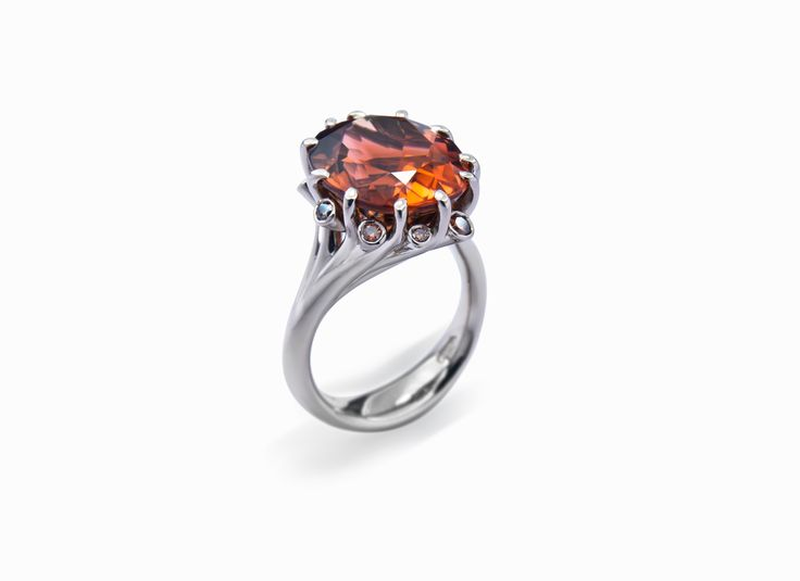 Summer Meadow ring with copper coloured tourmaline and diamonds in Fairtrade Ecological gold #JonDibben #Fairtradegold #Fairtrade #tourmaline