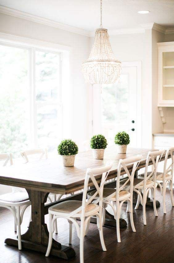 Can't decide if I like the x-back chairs...I do like the plants on table and the table itself. Maybe a little more rustic than I would like finish wise though