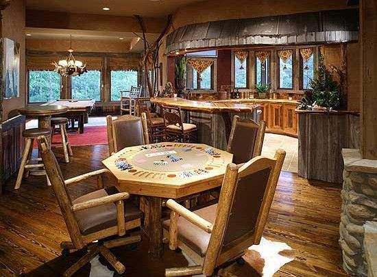 Home game room with a bar poker table set up and pool for Home bar game room