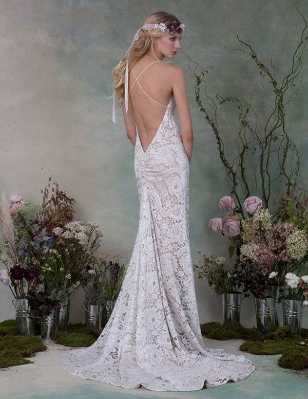 Stunning lace print wedding dress with nude slip underneath. | Elizabeth Fillmore Fall 2015 Wedding Dresses via @WorldofBridal