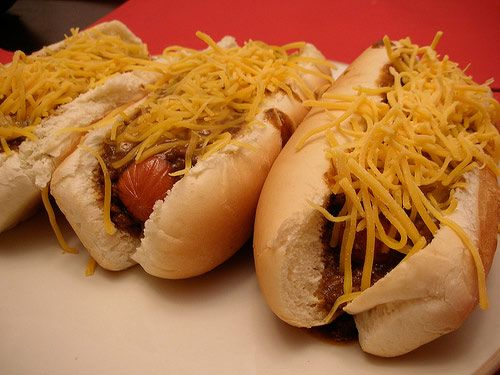 """Coneys are a favorite: small-sized, all-beef natural casing dogs served in steamed buns and topped with minced meat chili, mustard, and chopped onions (order the """"loaded"""" and you'll get shredded cheddar, too)."""
