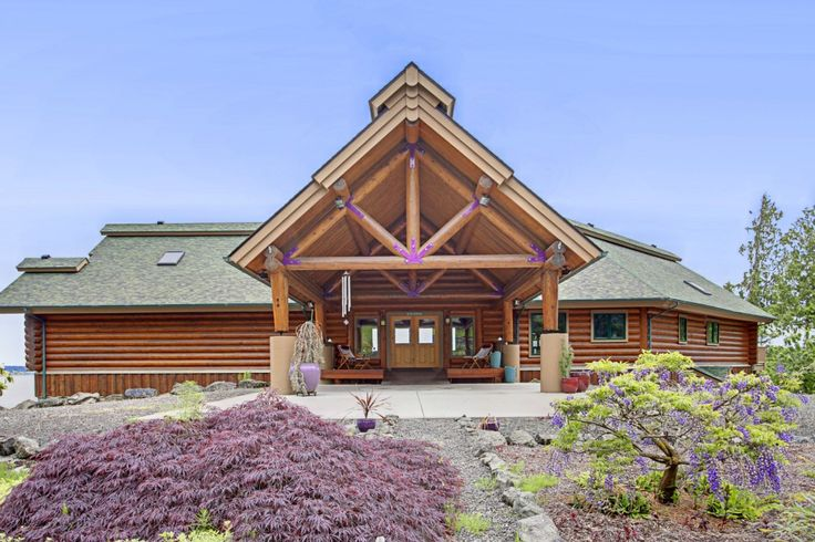 Custom waterfront log home sits on high bank with fantastic views of Hood Canal, Mt.Baker, & Driftwood Keys. Located at 13 White Rock Lane Port Ludlow, WA 98365. #SeattleRealEstate #SeattleHomes #SeattleRealtor #Seattle #RealEstate #Realtor #Homebuyers