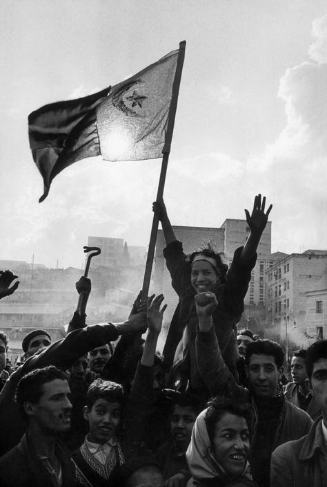 Algeria. Algiers. A group of young demonstrators raise fhe FLN flag. This was the first time that the green and white flag was wawed publicly in the streets of Algiers.1960