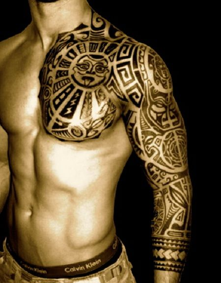 tribal tattoo idea for men on chest and shoulder