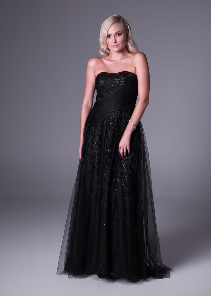 Spice up your usual black dress for formal functions. This elegant black creation will never go out of style, but still turn heads at your next special #event. Get this #Strapless, lace and tulle floor-length #dress from Bride&co stores. Click to View More or Book a Fitting Online