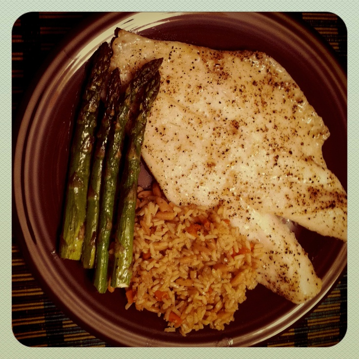 Home cooked meal.  Orange roughy, brown rice with orzo and roasted asparagus.  Delicious.
