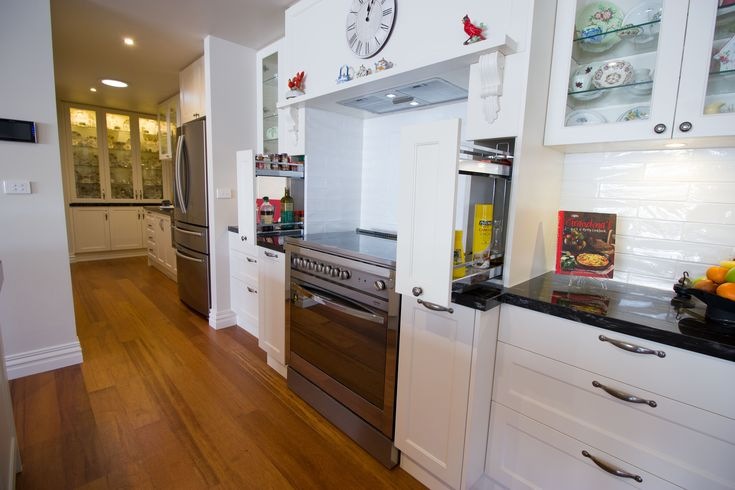 Traditional kitchen with on bench pull-out pantries. www.thekitchendesigncentre.com.au