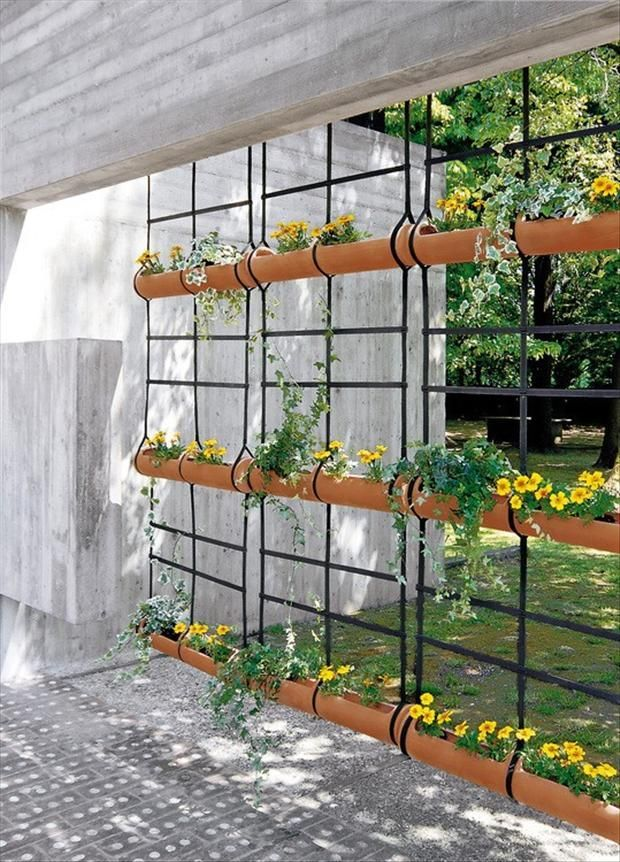 Gutters hanging as planters. Love This idea. Maybe straddling a railing with a few on each side, or in a rope wall. just tie them up as a sort of privacy wall.