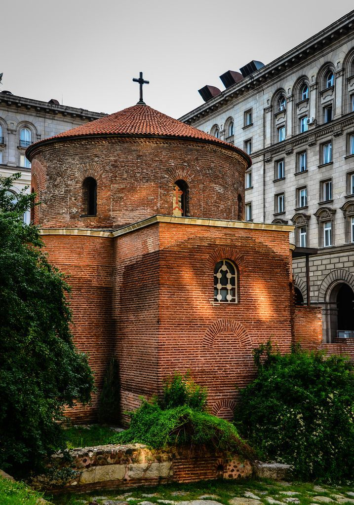 """The Church of St George (Bulgarian: Ротонда """"Свети Георги"""" Rotonda """"Sveti Georgi"""") is an Early Christian red brick rotunda that is considered the oldest building in Sofia, the capital of Bulgaria.[1] It is situated behind the Sheraton Hotel, amid remains of the ancient town of Serdica."""