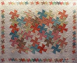 Here's a fun, modern twister quilt, quilted by L & R Designs Quilting!