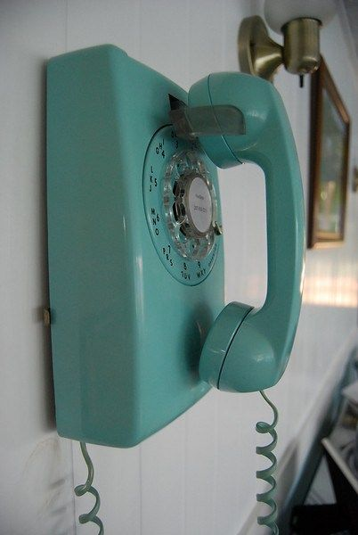 Old enough to remember standing by the wall to use the phone. The cord stretched forever....