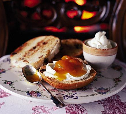 Toasted teacakes with apricot compote. Thick, creamy mascarpone and jam on hot teacakes are perfect for afternoon tea