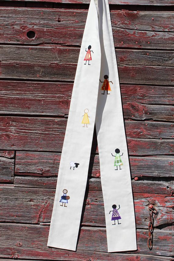 This stole celebrates diversity and inclusion in your congregation and community! It has six diverse people dancing. Their clothes form a pride rainbow. It is perfect for weddings, affirming congregation ceremonies, communion, Easter, funerals, baptism and confirmation.  It is 5 1/2 inches wide and 51 inches long and is made out of polyester-blend fabric. The curve of the neck makes it sit well and stay in place. It is a medium weight. The stole is made out of beautiful ivory white fabri...