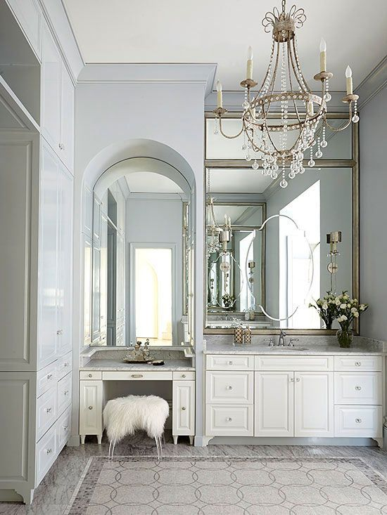Teaming pale blue with white is a no-brainer; the duo packs a pleasing punch in this master bathroom. A bit of silver and marble mosaic floor tiles bring an adult sensibility to what could otherwise be an overly sweet pastel scheme. /