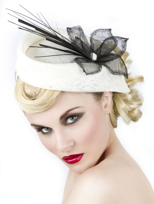 Cream and black facinator ..........very stylish for a wedding or confirmation etc.