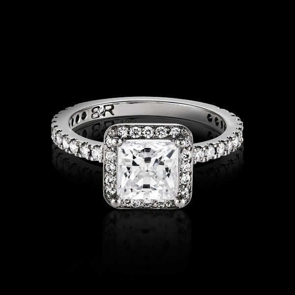 Orbis is BigRocxs' answer to fitting as much bling in an engagement ring as possible. This design features a diamond band as well as having the center diamond surrounded by full cut diamonds. A total of approximately 40 full cut diamonds helps make the center stone pop.
