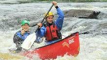 Shooting the rapids with an expert from Madawaska Kanu Centre.
