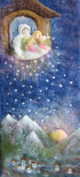 The good girl is helping Mother Holle shake her featherbed, making it snow on Earth.  A Grimm's fairy tale.  Wool pictures by Judit Gilbert