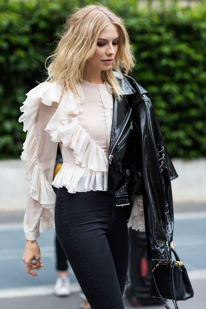 Paris Fashion Week Street Style: Ruffle blouse with long sleeves, patent leather jacket, black skinny jeans, and mini bag.