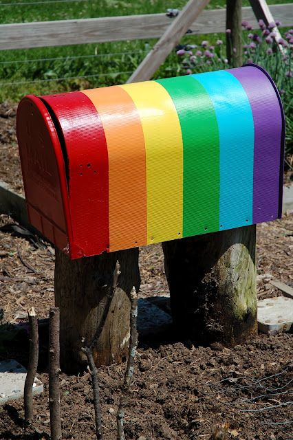 rainbow mailbox. place for garden tools-I would actually just use this for a mailbox.