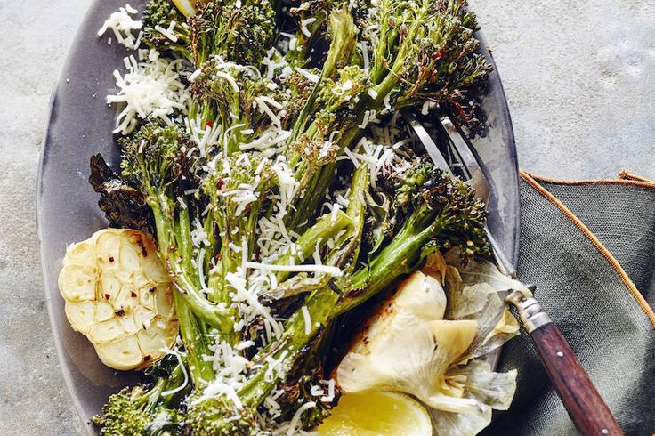 Roasted Broccolini with Garlic and Parmesan is hands down the best side dish recipe ever! Get the recipe here and you'll be hooked