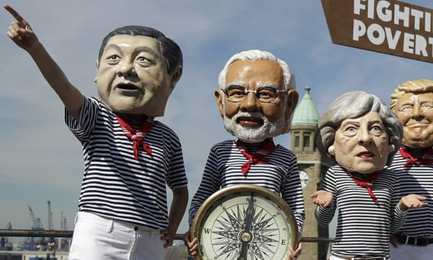 Oxfam activists in costume as Xi Jinping, Narendra Modi, Theresa May and Donald Trump during the G20 summit in Hamburg,