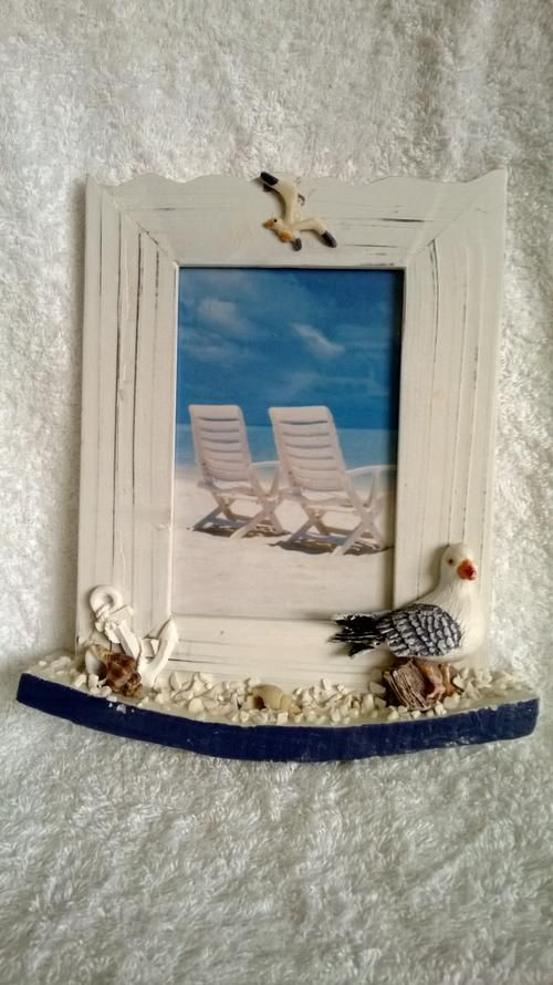 Buy WHITE WASHED PHOTO FRAME WITH DECORATIVE SEA THEME for R1.00