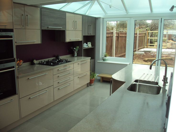 Cappucino gloss with Avola Brown Grey, siemens appliances and curved Corian solid surface tops...