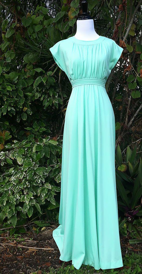 Vintage dress/1970s maxi dress/mint gown/1970s gown/mint colored dress/vintage dress. $60.00, via Etsy.