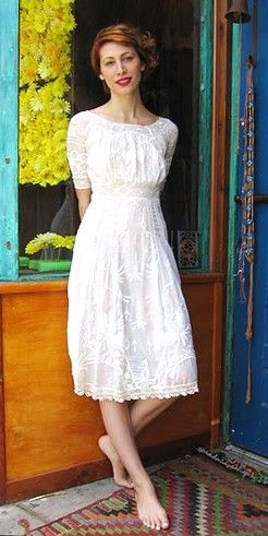 I want to find a vintage dress to wear with vintage boots for my brother's wedding..I like this, but in a different color, of course.