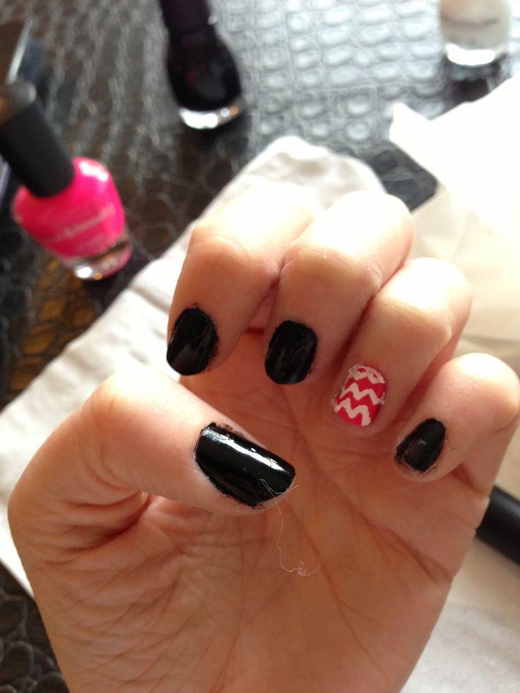 Black nail polish with pink and white chevron