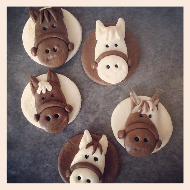 """Horse cupcake toppers (homemade choc and marshmallow fondant) inspired by """"Racing Savannah"""" by Miranda Kenneally."""