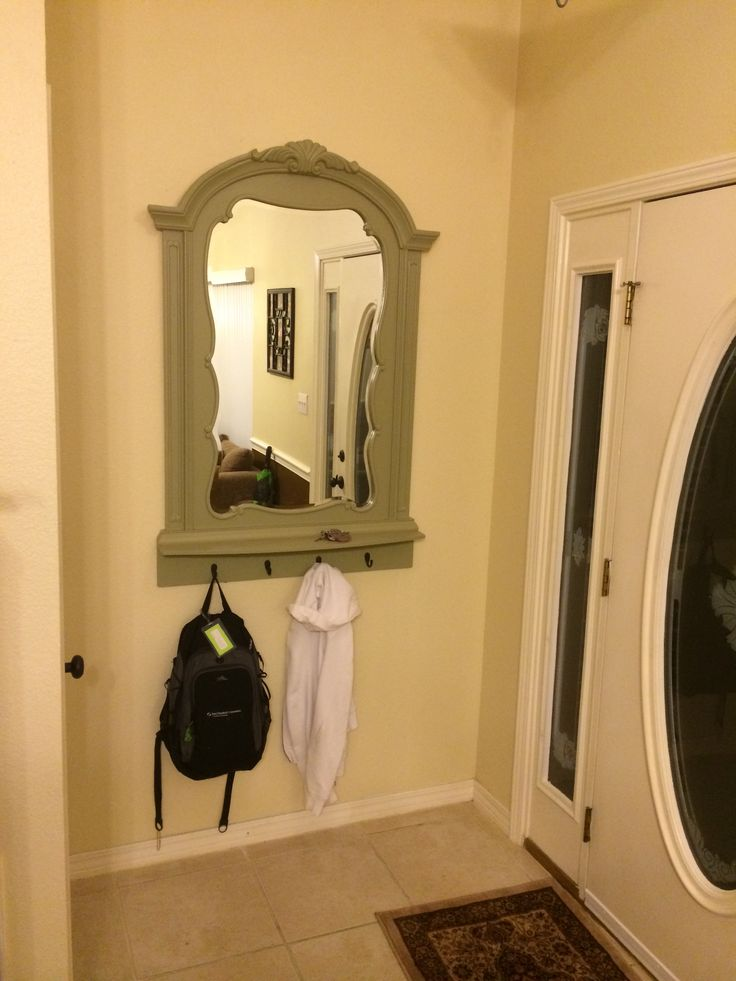 Repurposed mirror from a kids dresser into a coat rack/ key holder/ mirror.