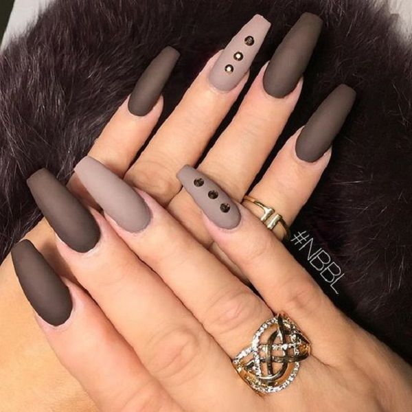 The Neutral Matte Brown Nails with Studs. Accentuate your nails with these simple yet stylish matte neutral colors on your coffin nails studded with diamonds.