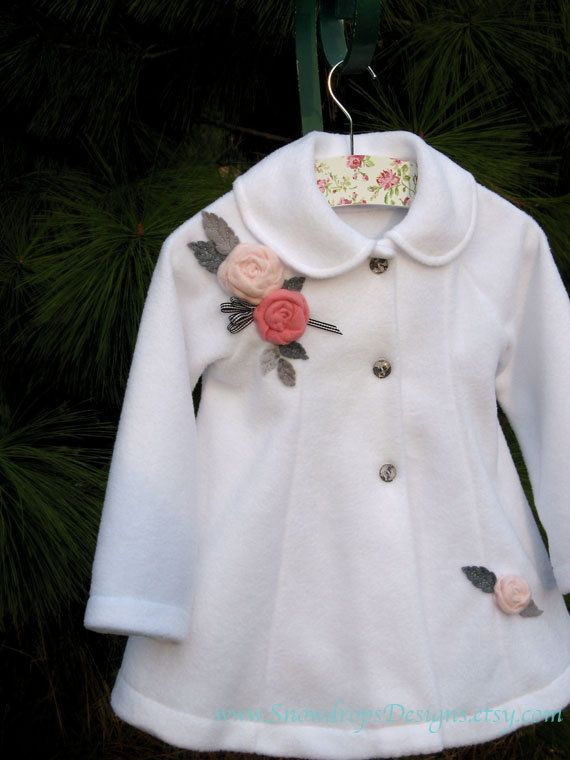 White swing coat for toddlers embellished with pink roses and grey leaves and black and white gingham ribbon, via Etsy.