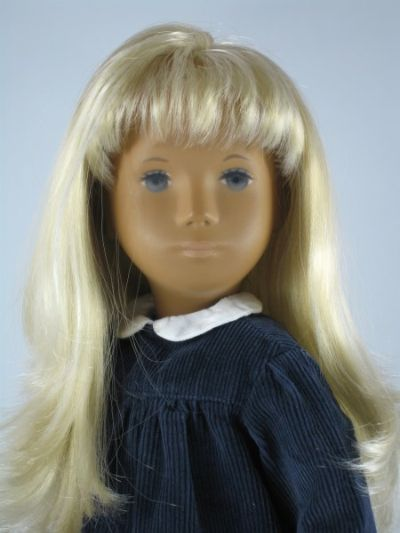 "15.5"" vinyl blonde Sasha Cord doll, wearing a navy corduroy version of the familiar yoked play dress, United Kingdom, 1970, by Trendon."