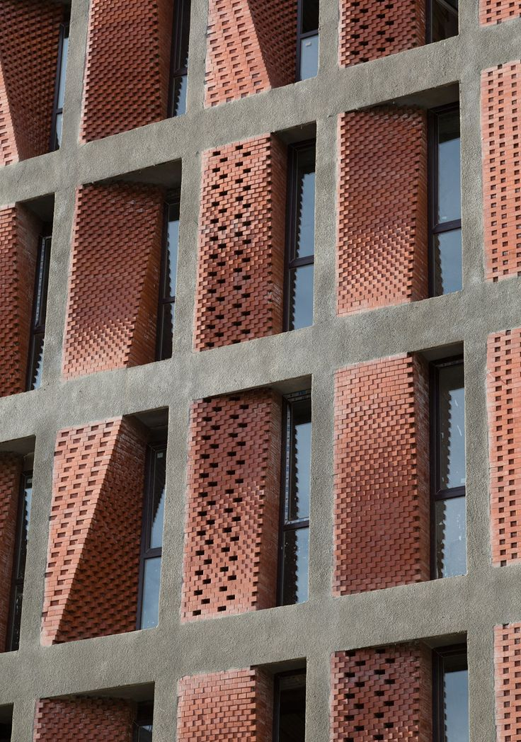 Angled screens of perforated brick provide ventilation and shade for this housing block in Tehran