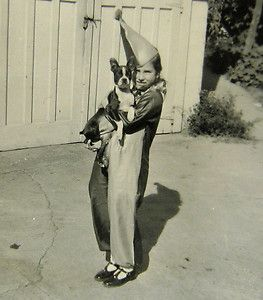 Girl in harlequin costume with Boston Terrier