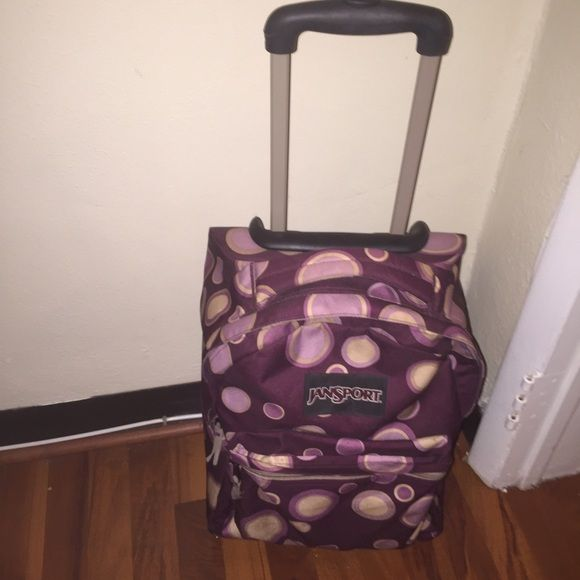 Adorable Jansport Rolling Backpack Jansport rolling backpack, eggplant color with adorable pink/purple bubble design.  Gently used and still in great condition.  Great for school or travel! Jansport Bags Backpacks