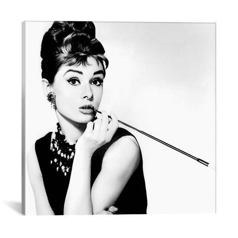 Radio Days BREAKFAST AT TIFFANY'S SERIES: AUDREY HEPBURN SMOKING