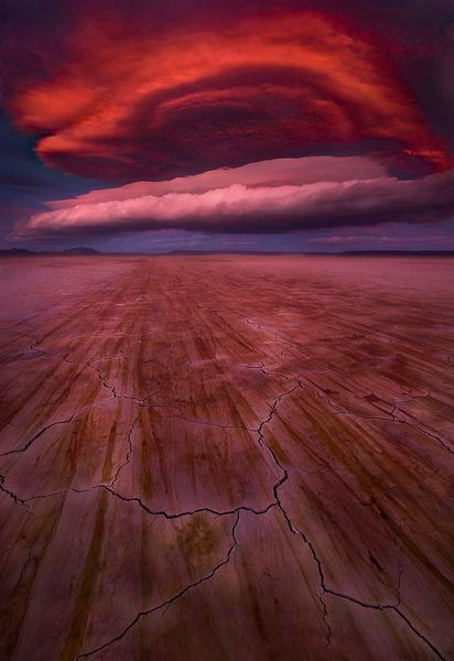 'The Fireball', Alvord Desert, Oregon by Marc Adamus - Surreal, otherworldly, foreboding...perhaps a once in a lifetime combination of colors, shapes and textures. This awesome lenticular cloud formation occured at sunset over Oregon's Alvord desert in late December, ahead of an impending storm.