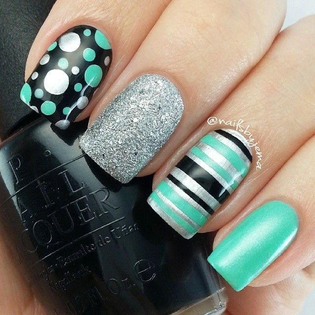 love the black,turquoise, and silver nails with a cute polka dot and stripe pattern! :)