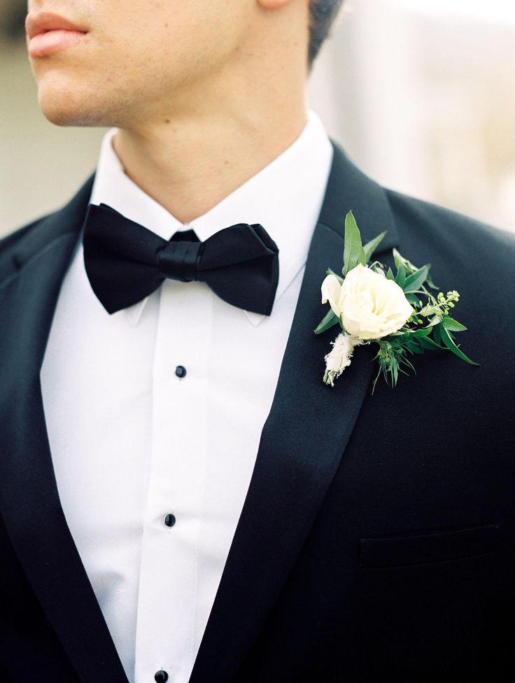 Classic groom attire, black bowtie, cream floral bout, formal // Lissa Ryan Photography