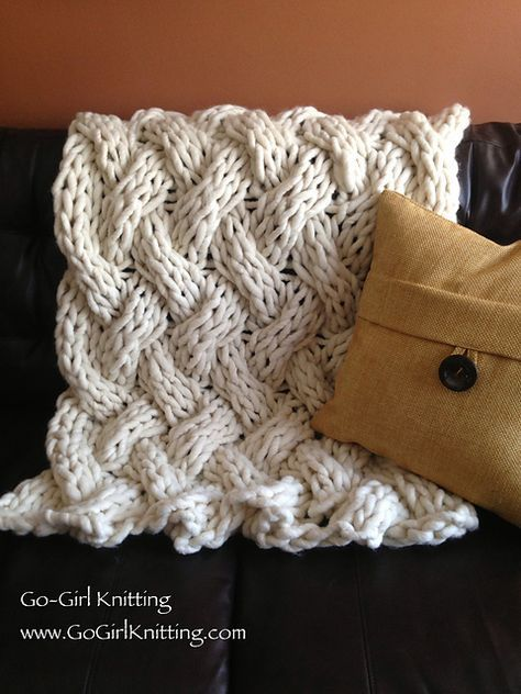 I really want a big knitted throw for my couch.  Not sure if my stubby fingers can handle the big needles though.