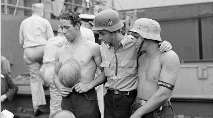 US Sailors with helmets from North Africa one is possibly a French or an Italian M26 model.Also visible Hermann Göring division cufftitle.