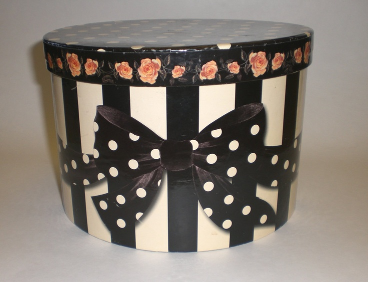 Oui Oui .. a cheerful Parisian vintage hat box organizer.  I have Grandma W's old hat box and a hat - maybe for cards??