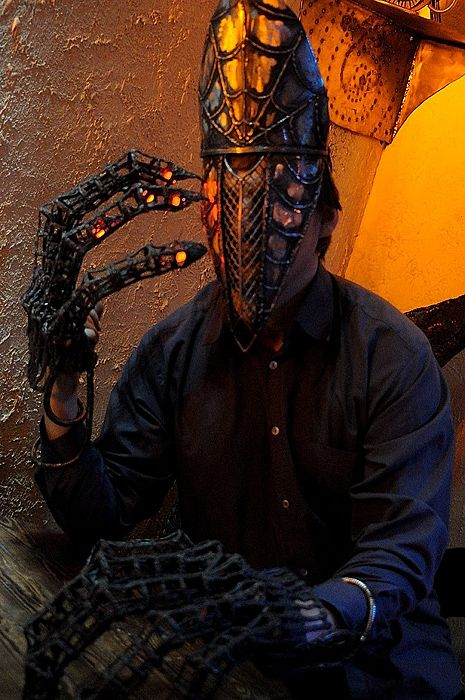 Metal hands and mask welded from scrap. Surindustrialle Gallery in Lodz / Poland. Scrap metal art, welding applied art and jewellery