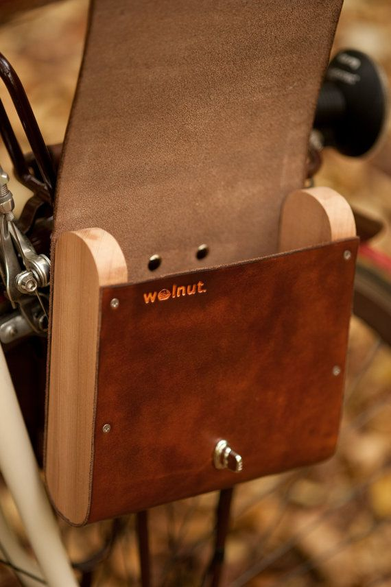 "A stylish and aromatic leather and cedar pannier for your bicycle, perfect for the contents of your pockets on a ride.   Named ""the pocket pannier"", this side bag is designed to hold the contents of your pockets during a ride. The large size is big enough to hold the Kryptonite Mini Evo 5 u-lock.   Hand-finished USA-made thick vegetable tanned leather is wrapped around aromatic (and sustainably harvested) Northwest-grown, FSC-certified cedar side panels.   Cedar is lightweight. This bag…"